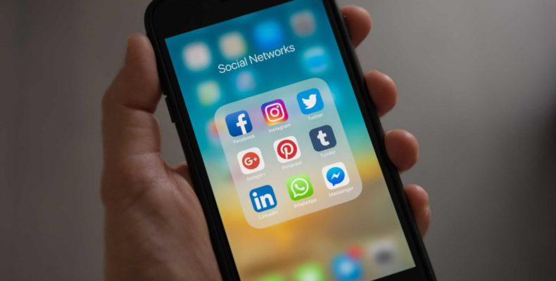 Smartphone with Social Media Applications on screen